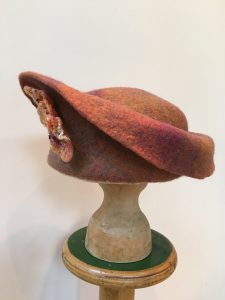 Rust felt hat with uplift brim